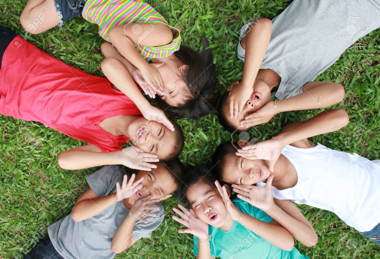 Six children playing in the park. - 50549364