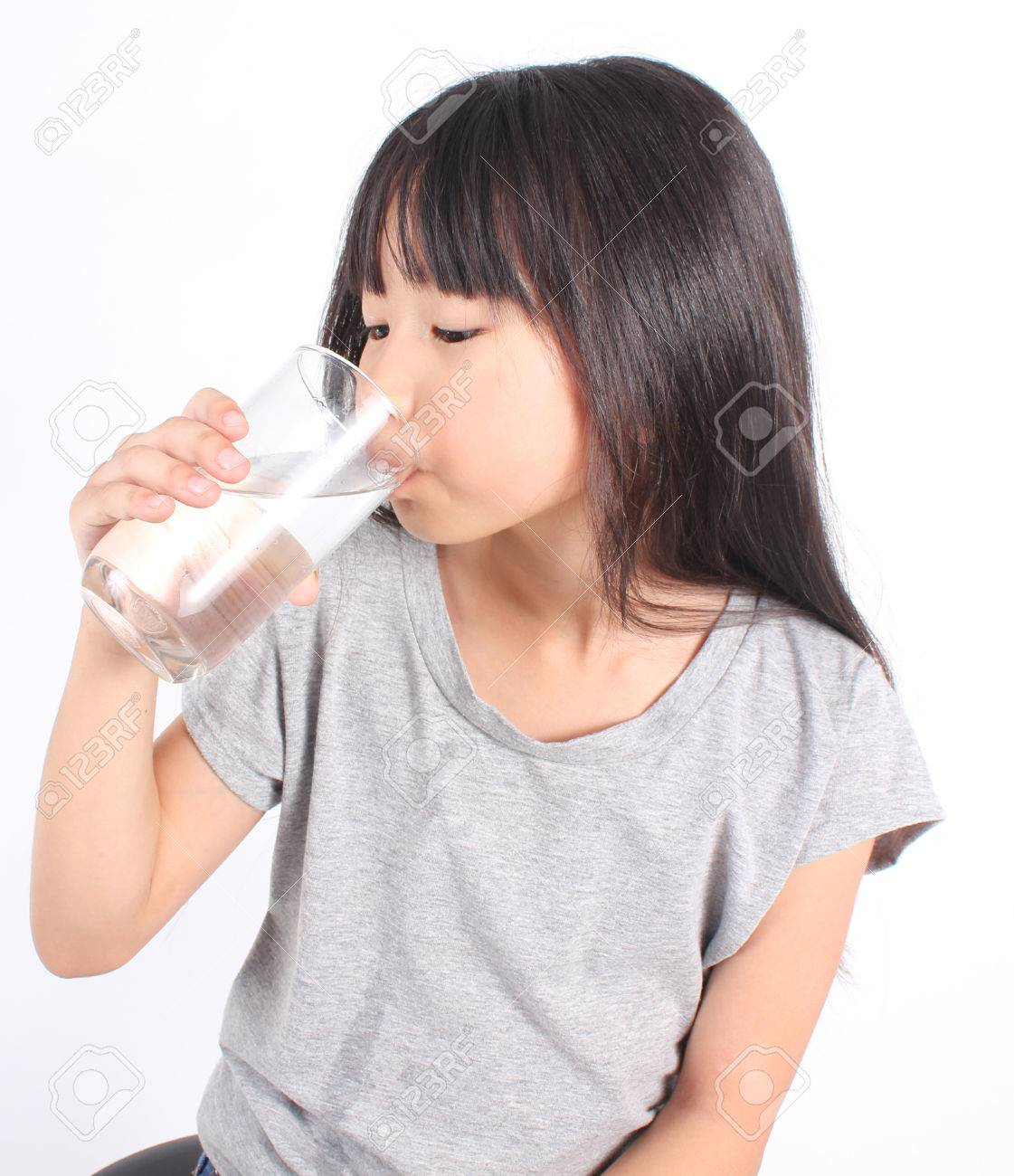 Young little girl drinking water. - 51071326