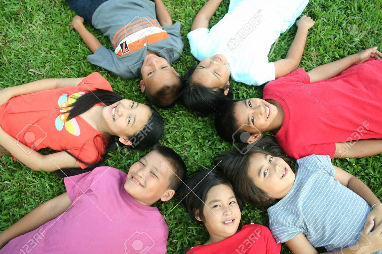 Seven children sleeping in the park. - 51685808