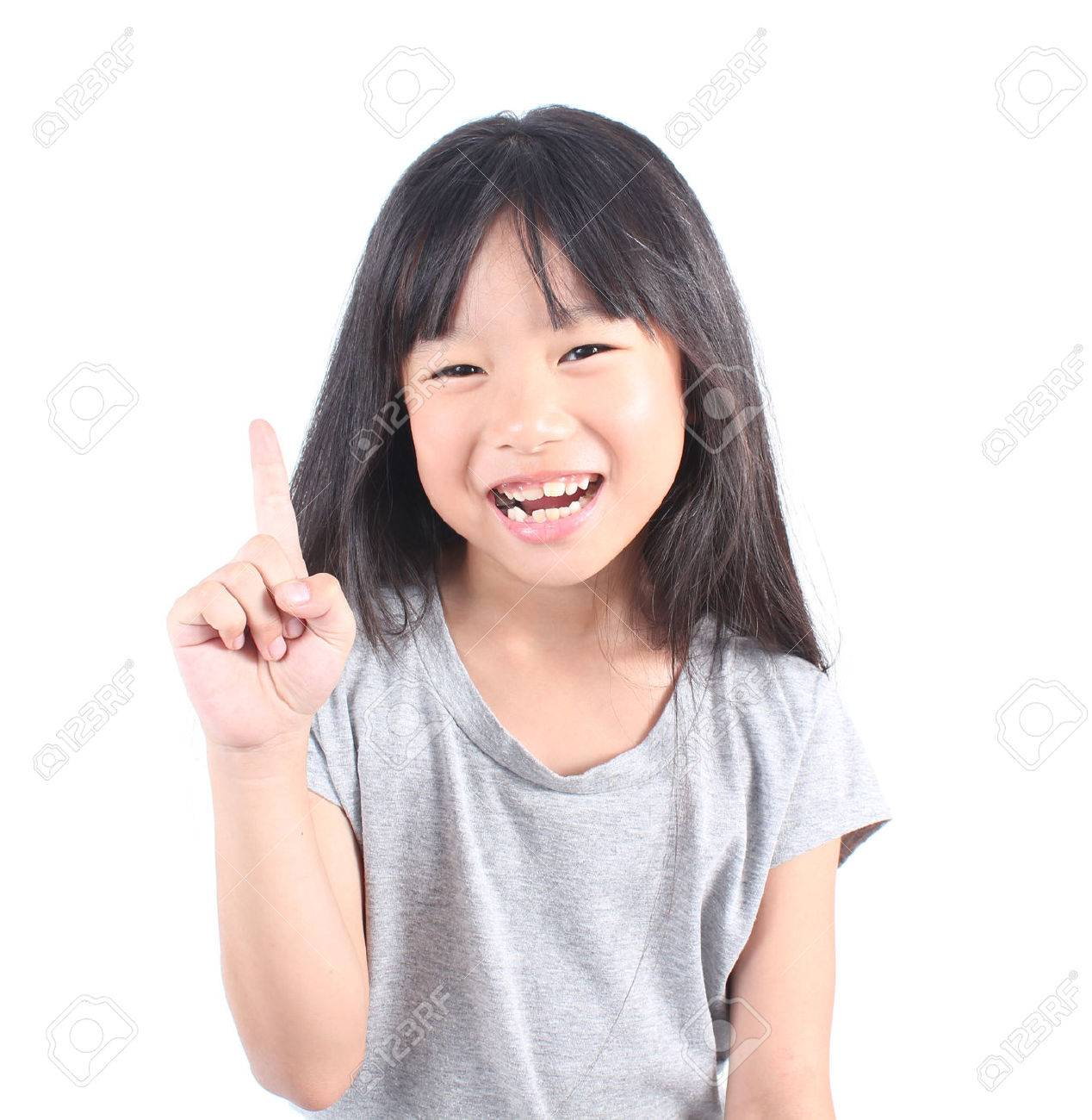 Little girl pointing up with her finger - 51688213