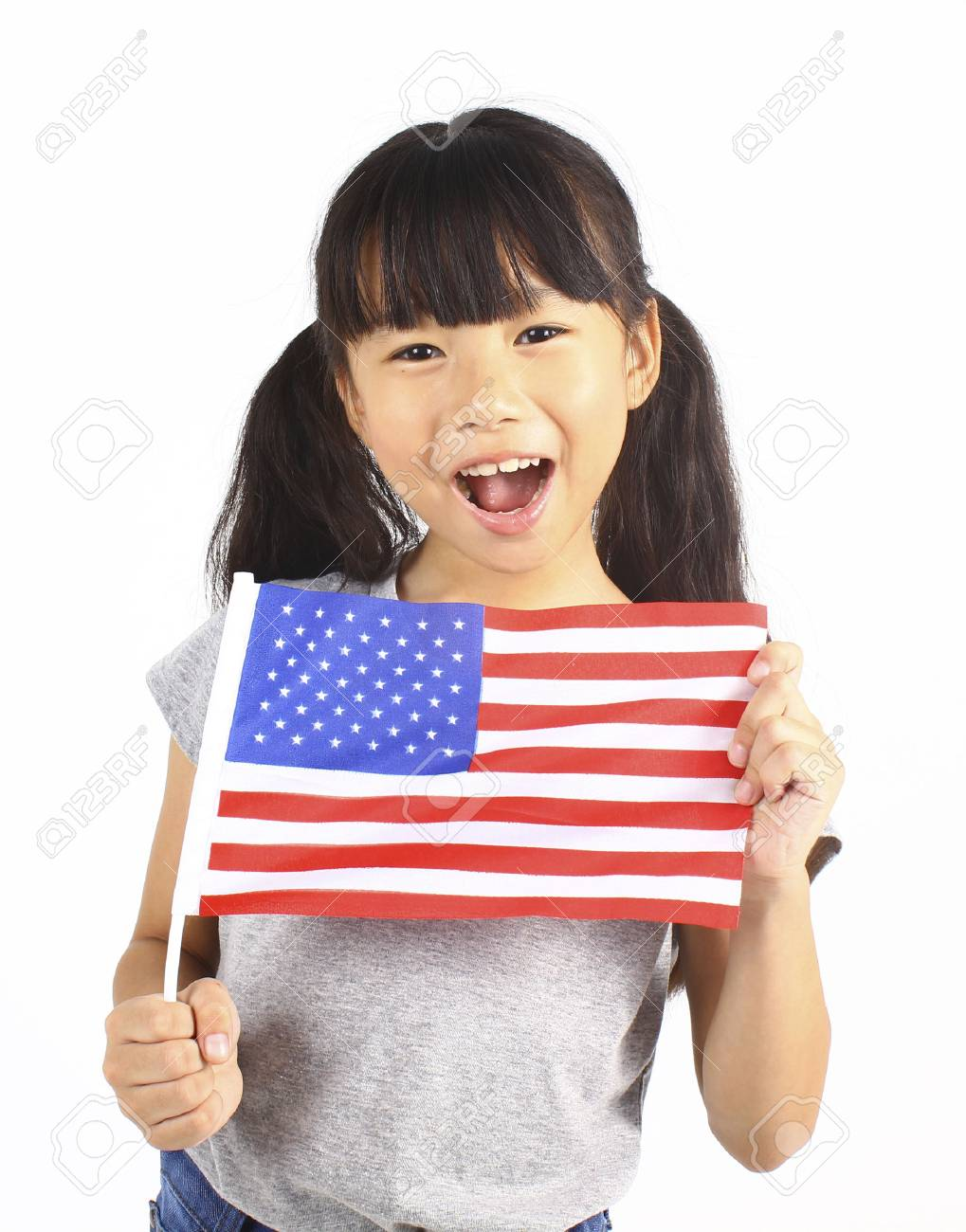 Cute girl holding an American Flag - 52379974