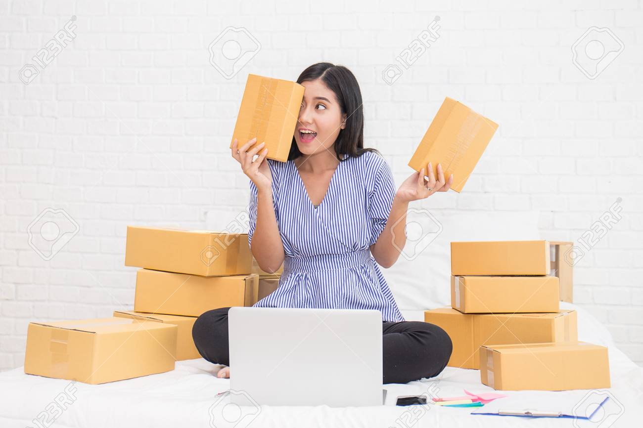 Start up small business entrepreneur or freelance woman working at home, in bed concept, Young Asian small business owner at home office, on line marketing packaging and delivery - 83058159