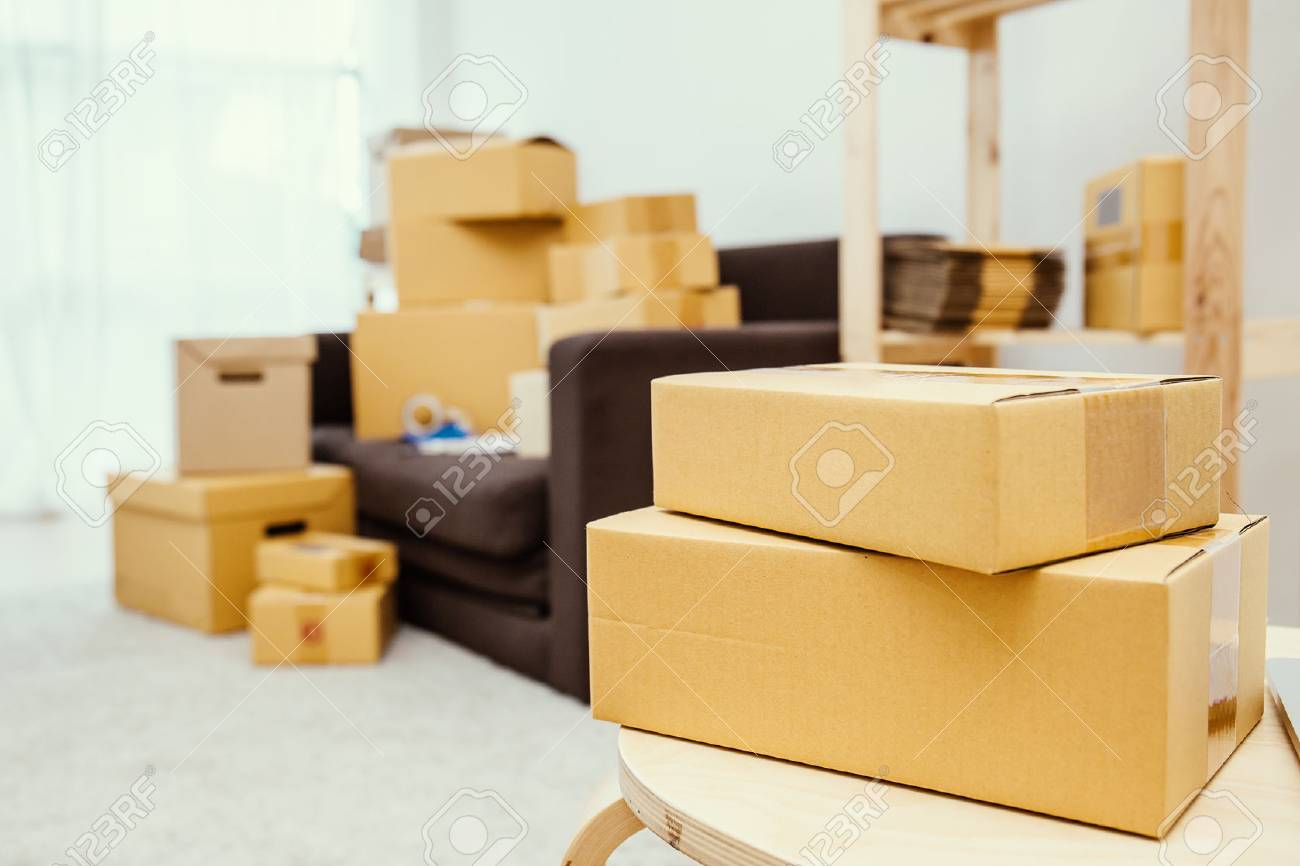 arrangement of empty cardboard packing boxes standing on a floor