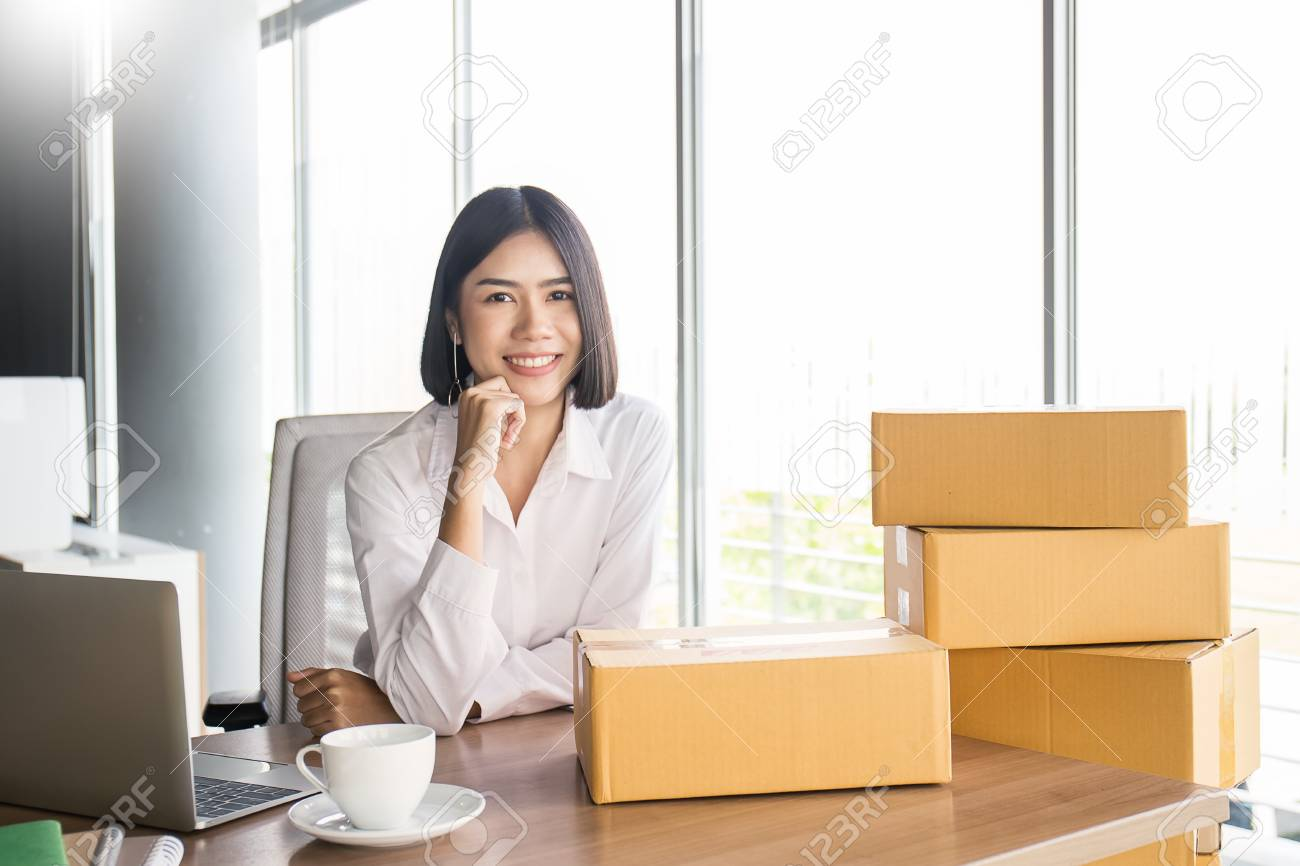 Start up small business entrepreneur SME or portrait freelance woman working with box at home concept, Young Asian small business owner, online marketing packaging and delivery, SME concept - 90504206
