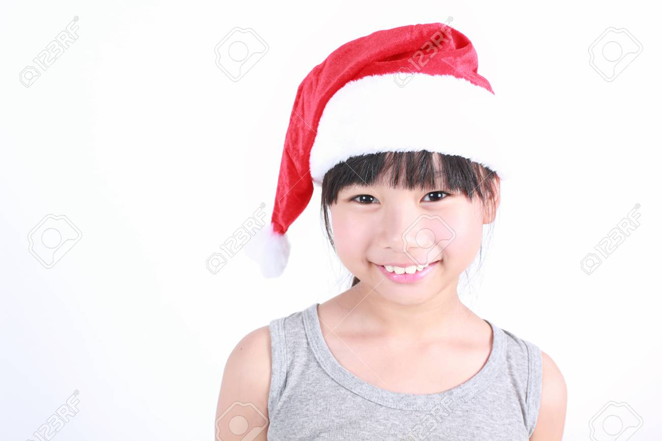 641e23b2ca0 Portrait Of Little Cute Asian Girl Wearing Red Santa Hat