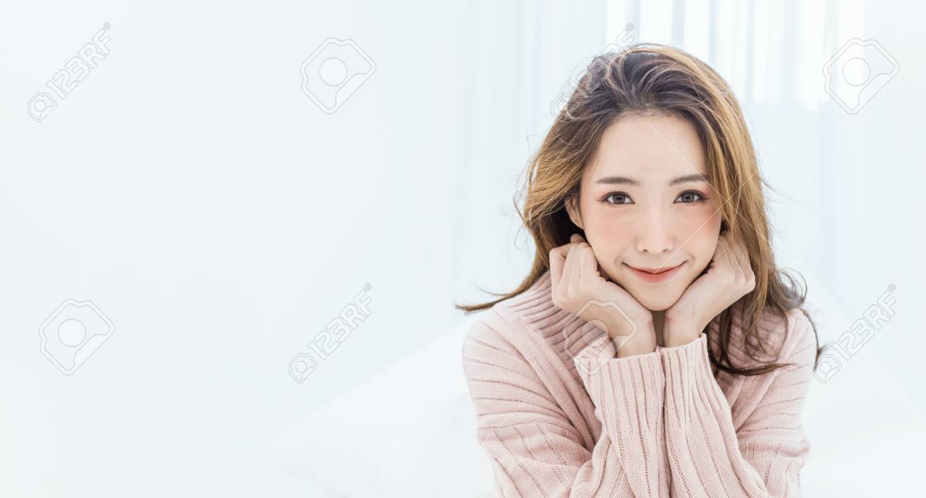 Portrait of young beautiful asian woman relax in her bedroom. Smile happy asian girl isolated on white background banner. - 112540679