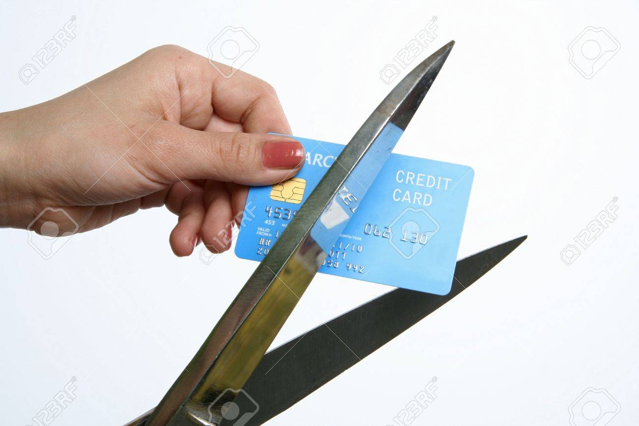 cutting up credit card with scissors Stock Photo - 3917137