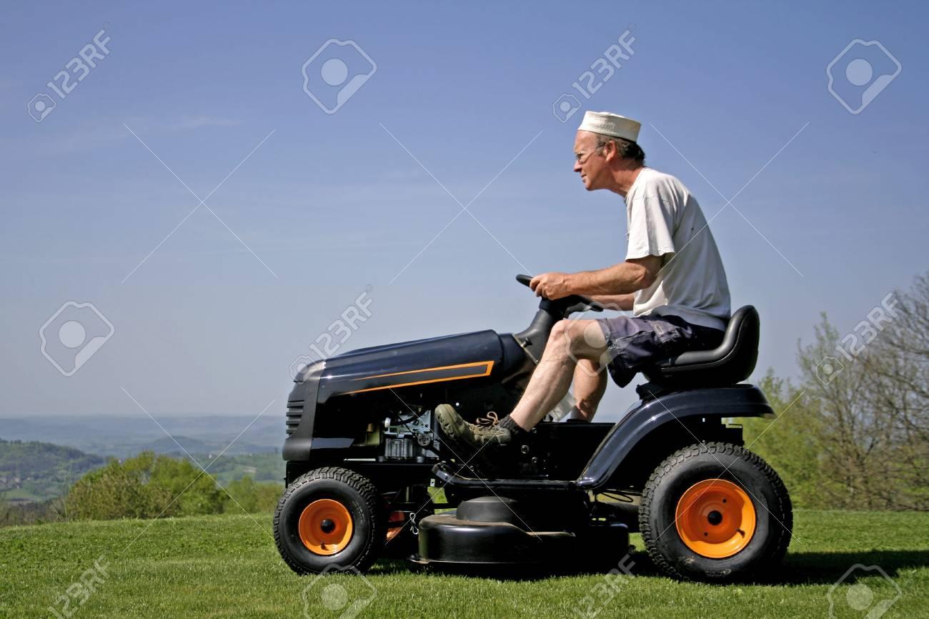 man sitting on lawn mower Stock Photo - 3934871