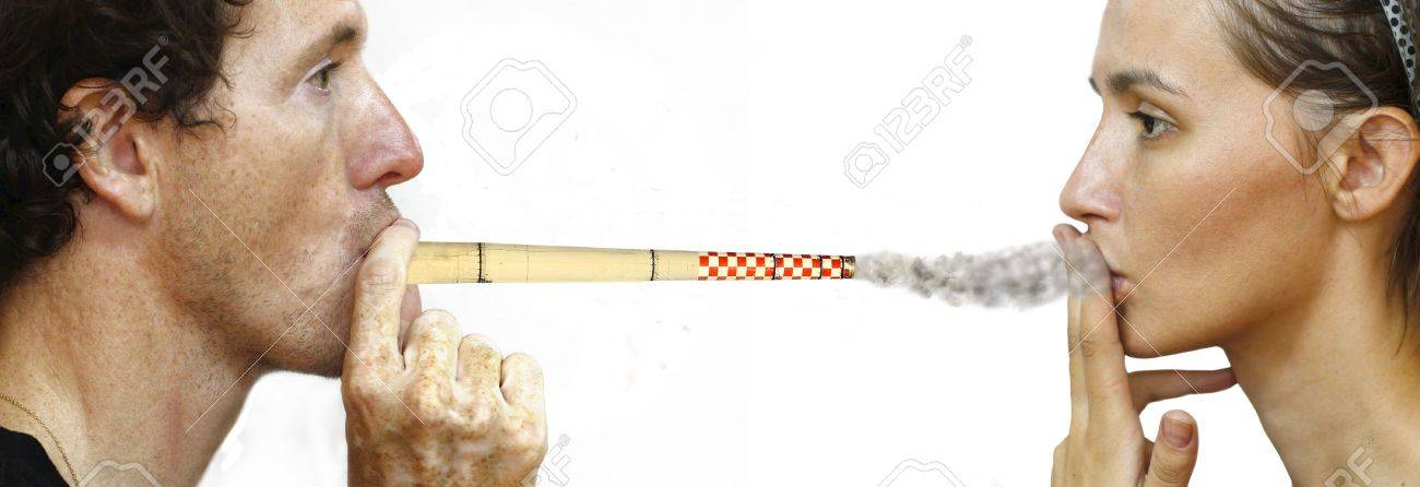 man intoxicating woman by smoking a chimney Stock Photo - 3992675