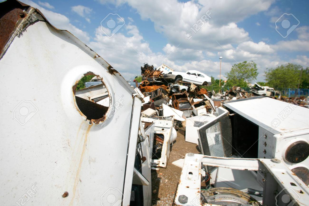 Cars piled on top of each other in junkyard Stock Photo - 5690221
