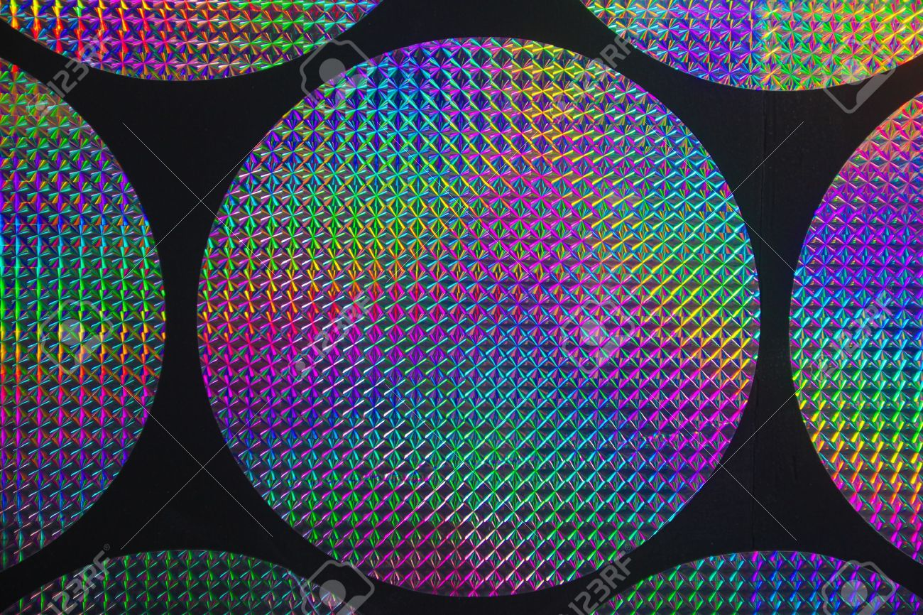Circular holographic patterns of on background Stock Photo - 8985185
