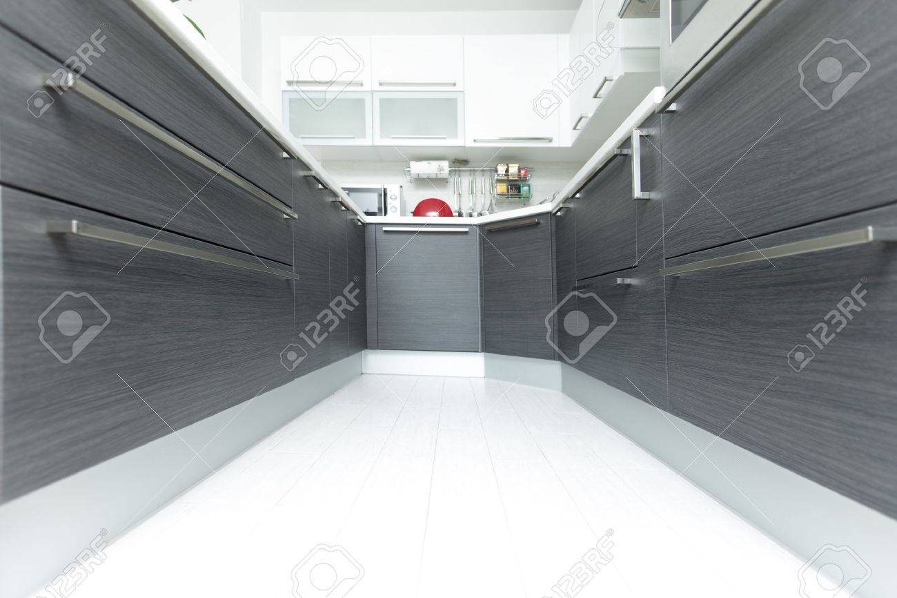 Open-plan kitchen interior perspective in modern home Stock Photo - 16467368