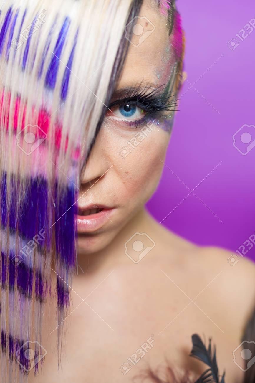 Close up of woman with multicoloured hair and blue eyes Stock Photo - 16467418