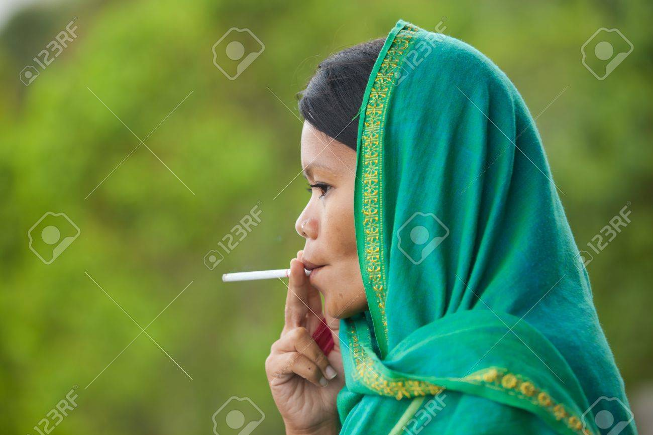 https://previews.123rf.com/images/paulprescott72/paulprescott721212/paulprescott72121200153/17259916-south-east-asian-woman-with-head-dress-smoking.jpg