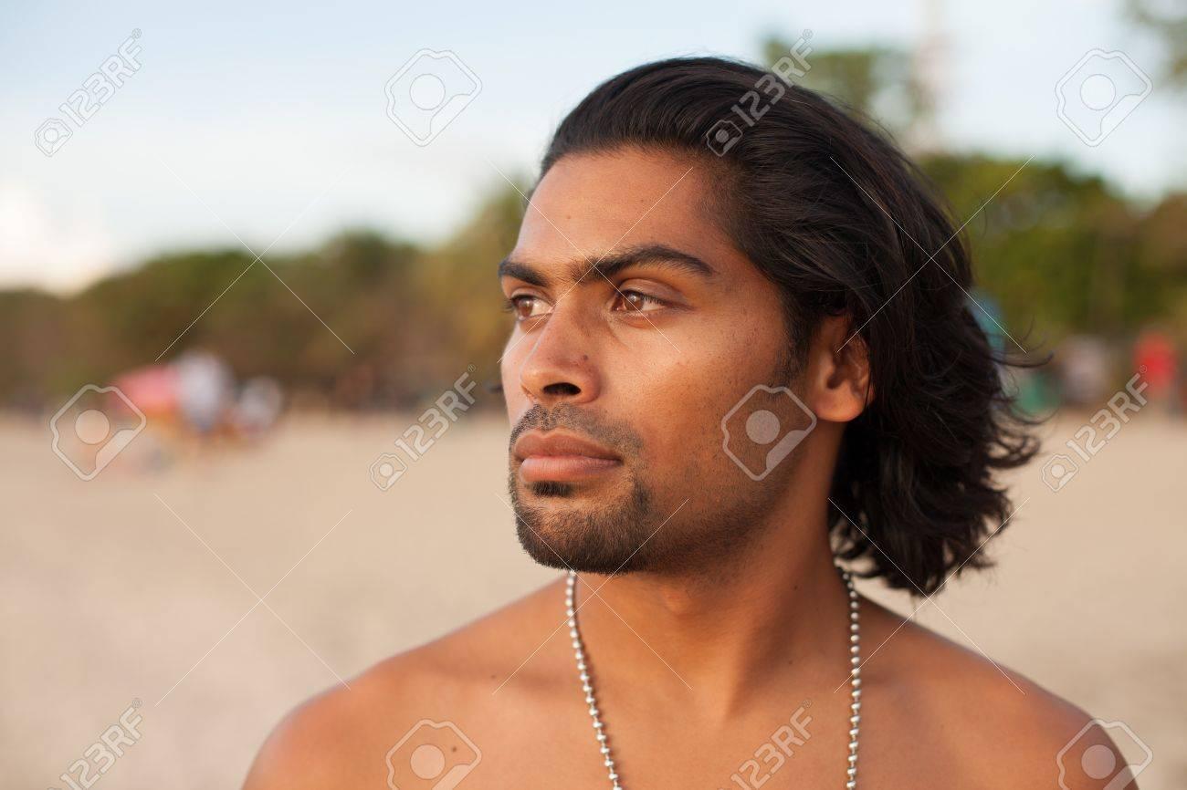Portrait of handsome multi-ethnic man on beach at sunset Stock Photo - 17260037