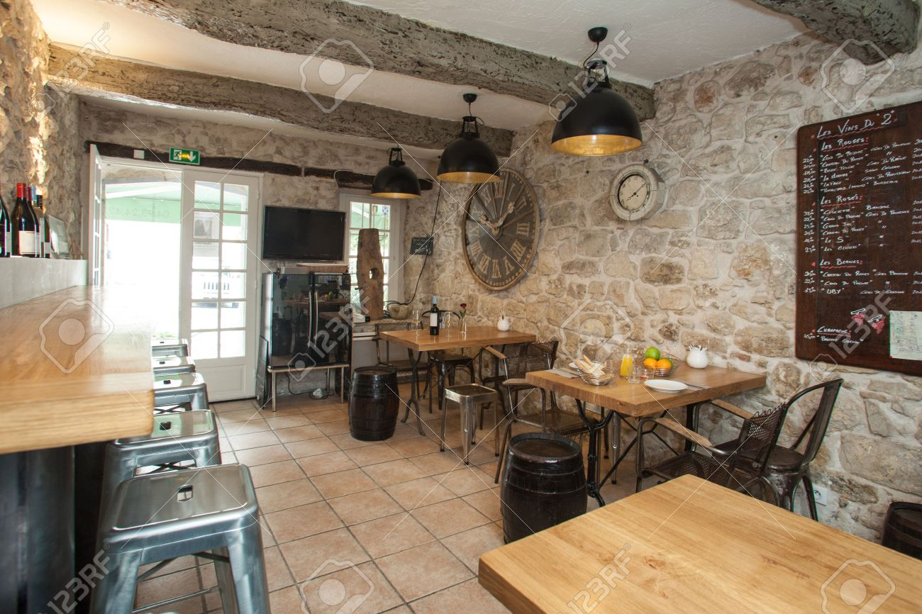 Rustic restaurant furniture - Interior Of French Bistro With Rustic Furniture Stock Photo 24854227