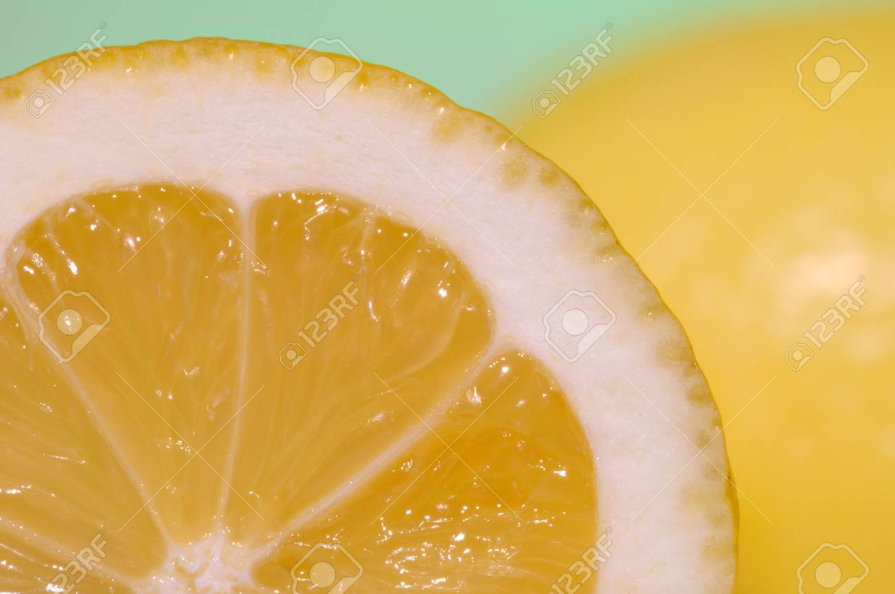 A shot of two lemons one is cut in half Stock Photo - 4708229