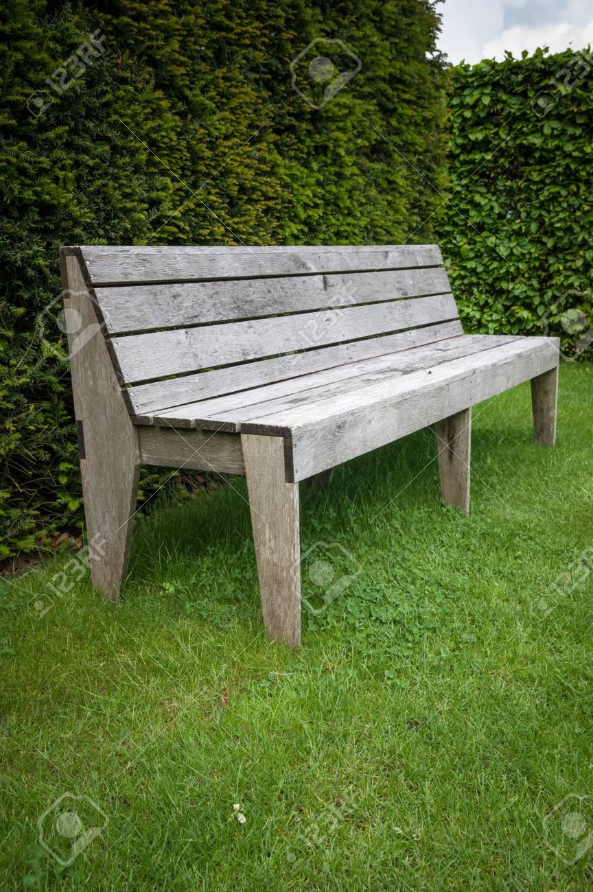 Wondrous Unusual Oak Wood Garden Seats In A Formal English Garden Setting Creativecarmelina Interior Chair Design Creativecarmelinacom