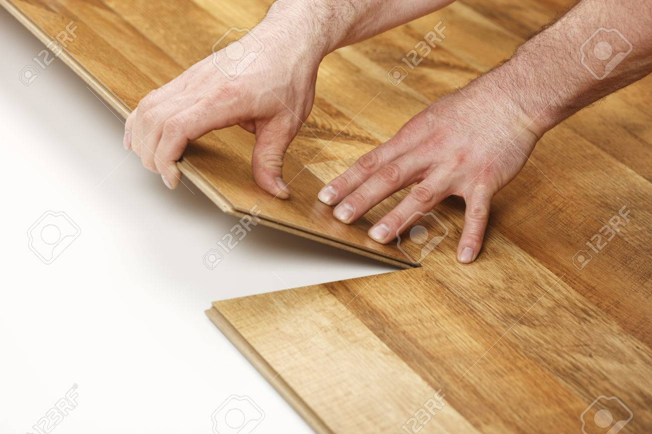 installing laminate flooring. Installing Laminate Flooring Stock Photo - 34197397