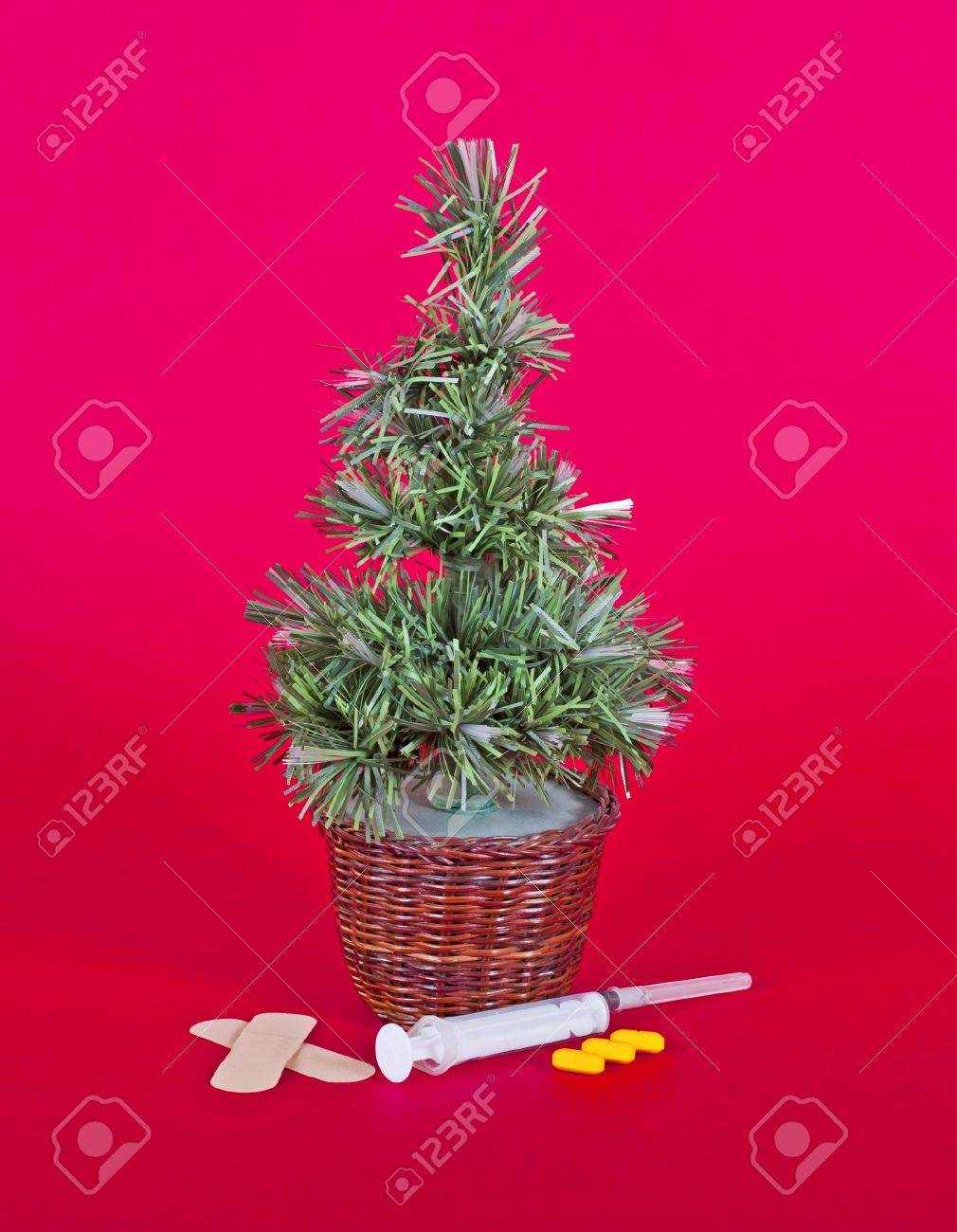 small christmas tree with medical drug equipment isolated on