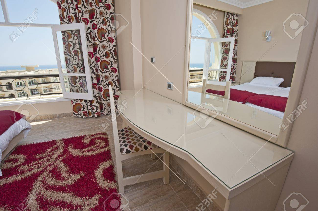 Luxury Hotel Bedroom Dressing Table And Mirror With A Tropical Sea View  Stock Photo   14716020