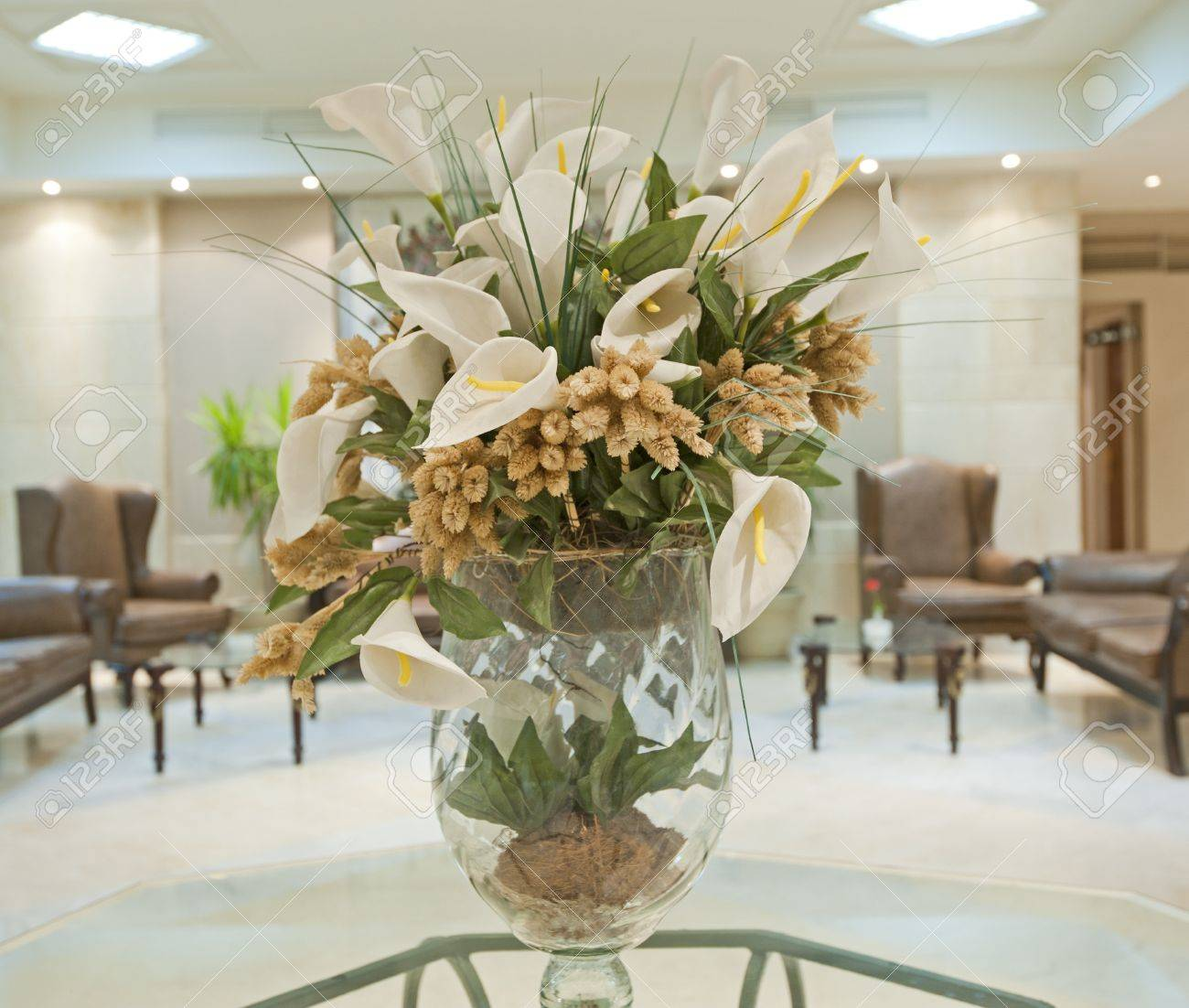 Artificial flower display in a glass vase on table of hotel lobby artificial flower display in a glass vase on table of hotel lobby stock photo 14942492 mightylinksfo