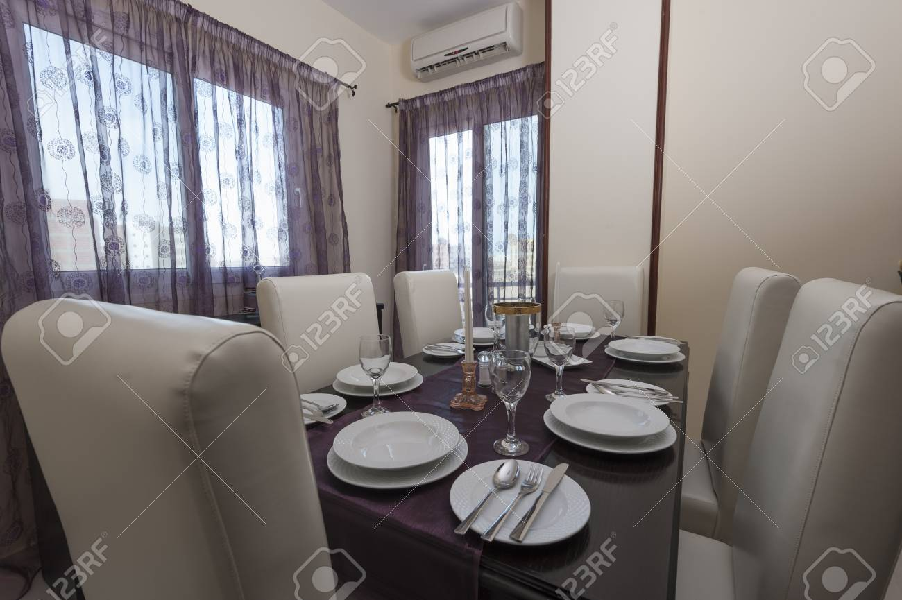 Dining Room Settings Dining Room With Table And Settings In A Luxury Apartment Stock