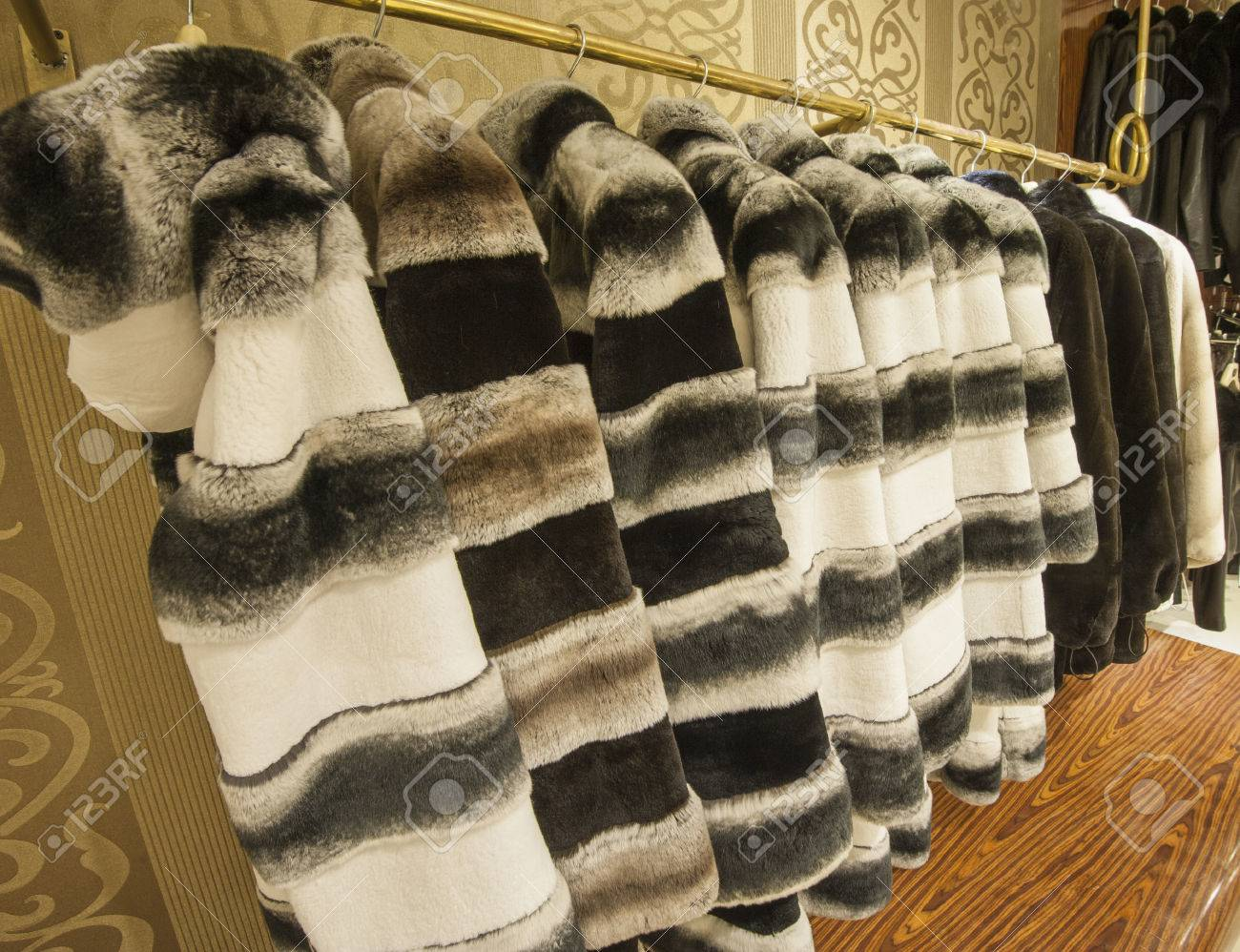 Expensive Genuine Fur Coats Hanging On A Rail In Shop Stock Photo