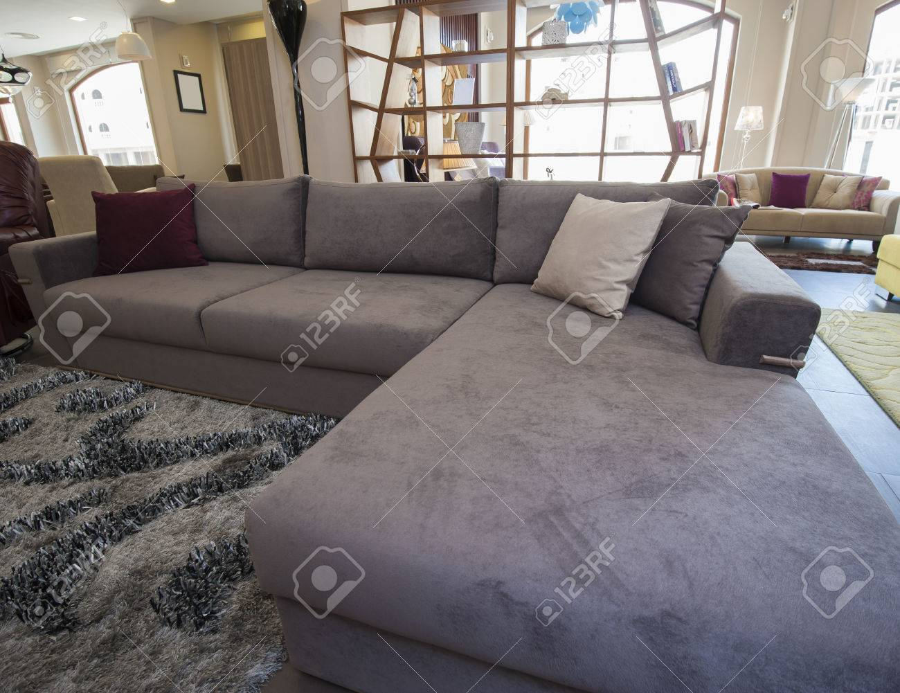Large L-shaped Corner Sofa In Living Room Furniture Show Home Stock ...