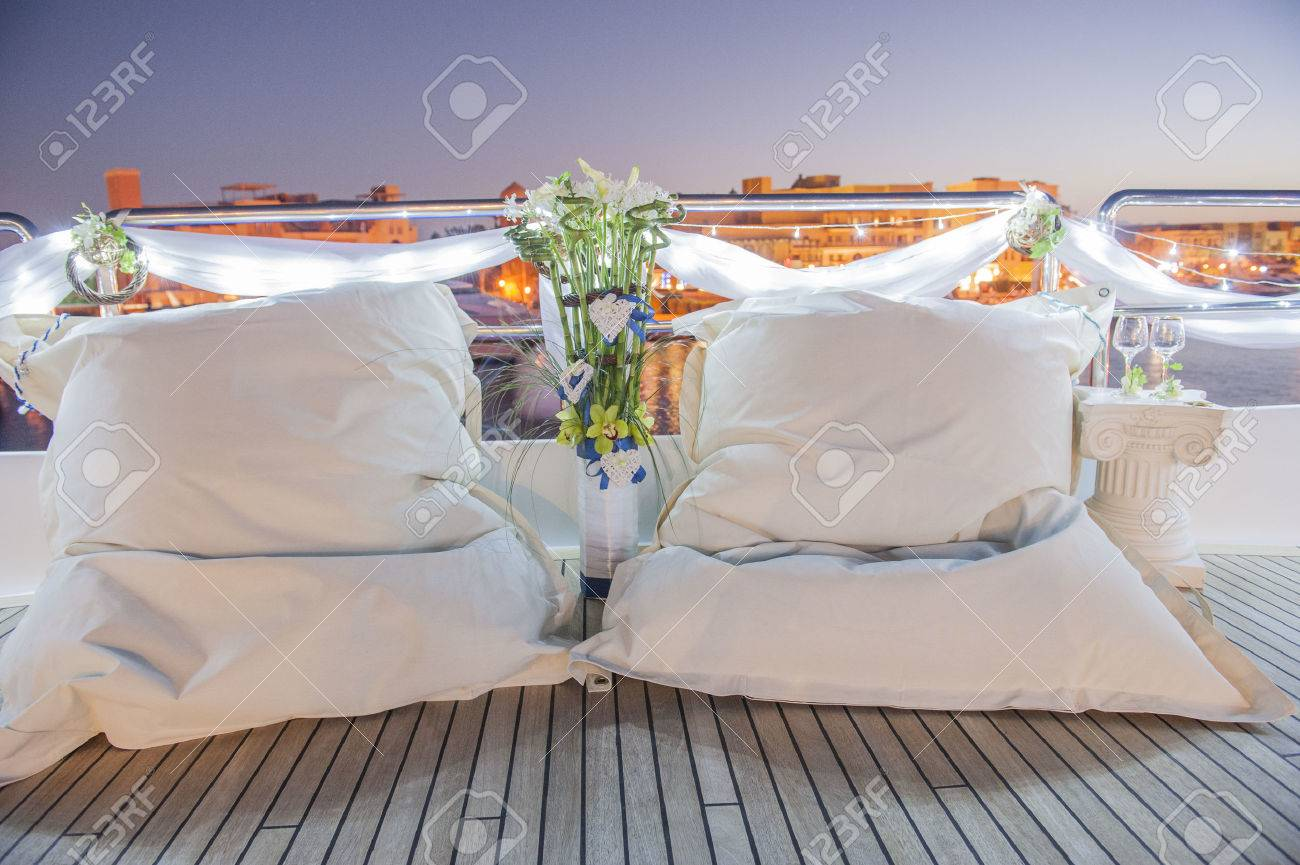 Admirable Pair Of Large White Bean Bag Cushions On Deck Of Boat In Marina Gmtry Best Dining Table And Chair Ideas Images Gmtryco