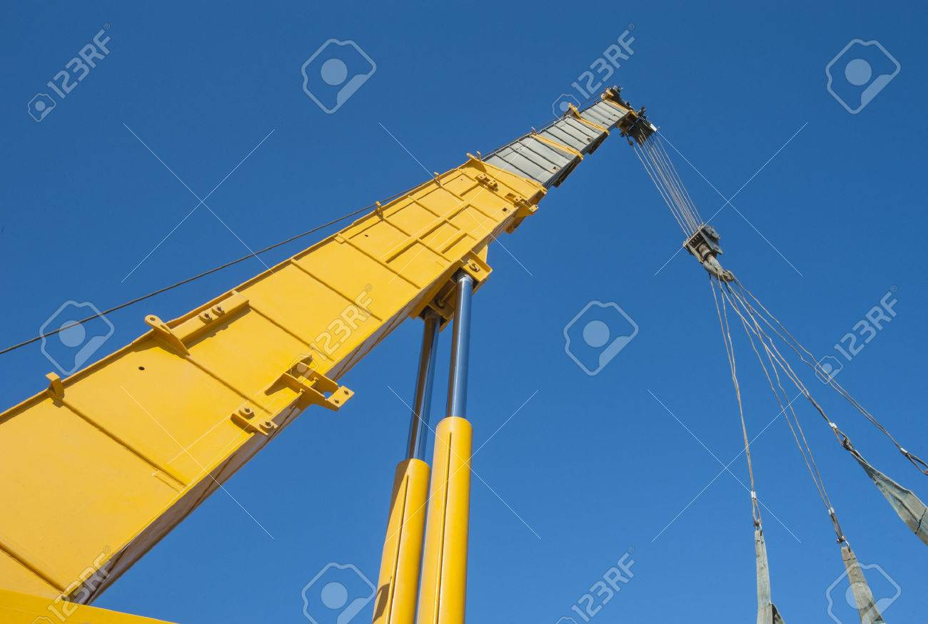 Large Extended Industrial Crane Jib Boom Arm Against A Blue Sky ...
