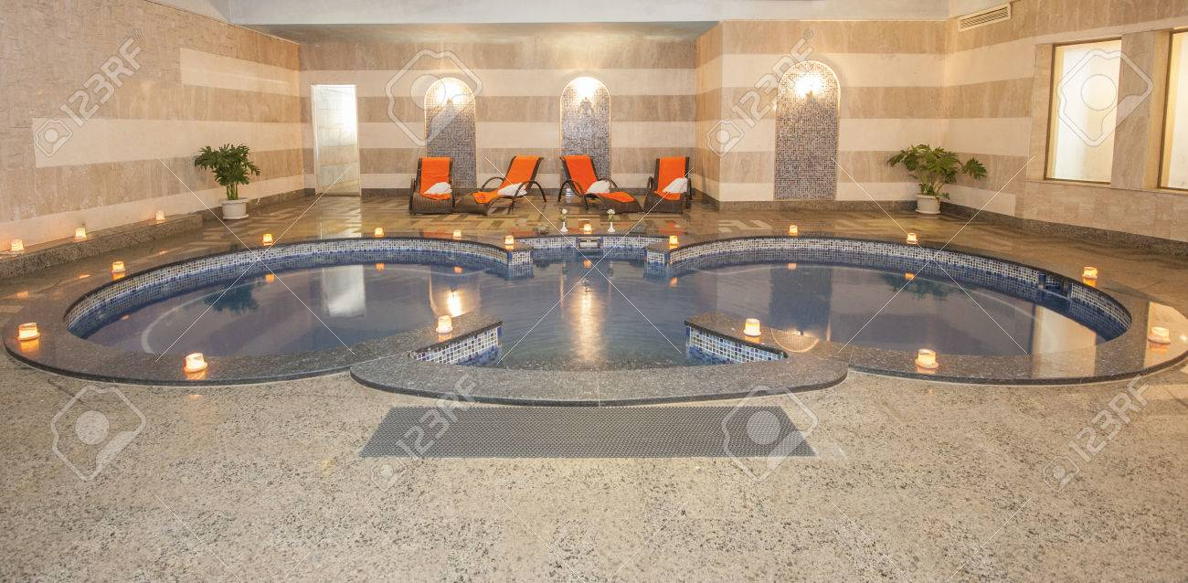 Large Jacuzzi Pool In Room Of Luxury Health Spa Center With Candles ...