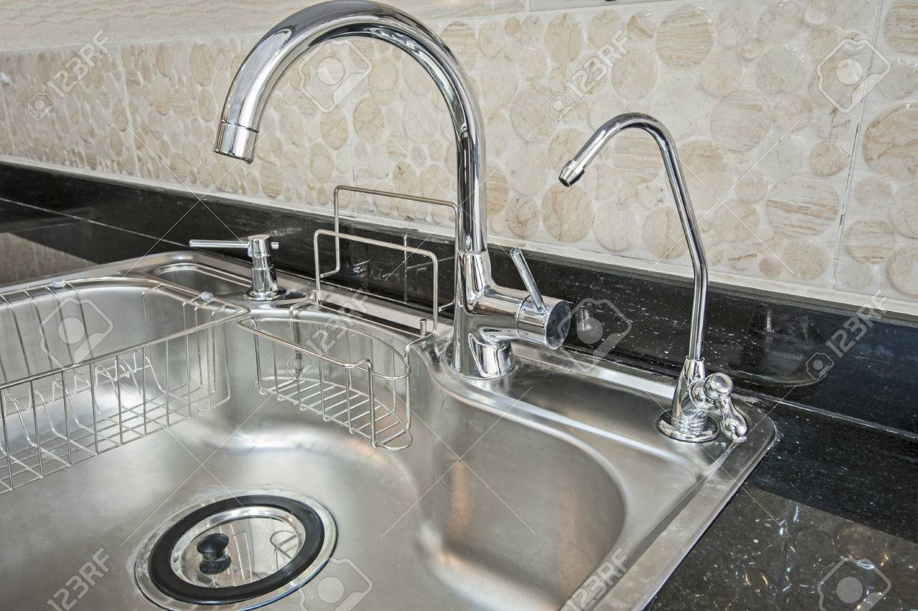 Closeup Detail Of A Metal Kitchen Sink With Two Taps In A Luxury Interior  Stock Photo
