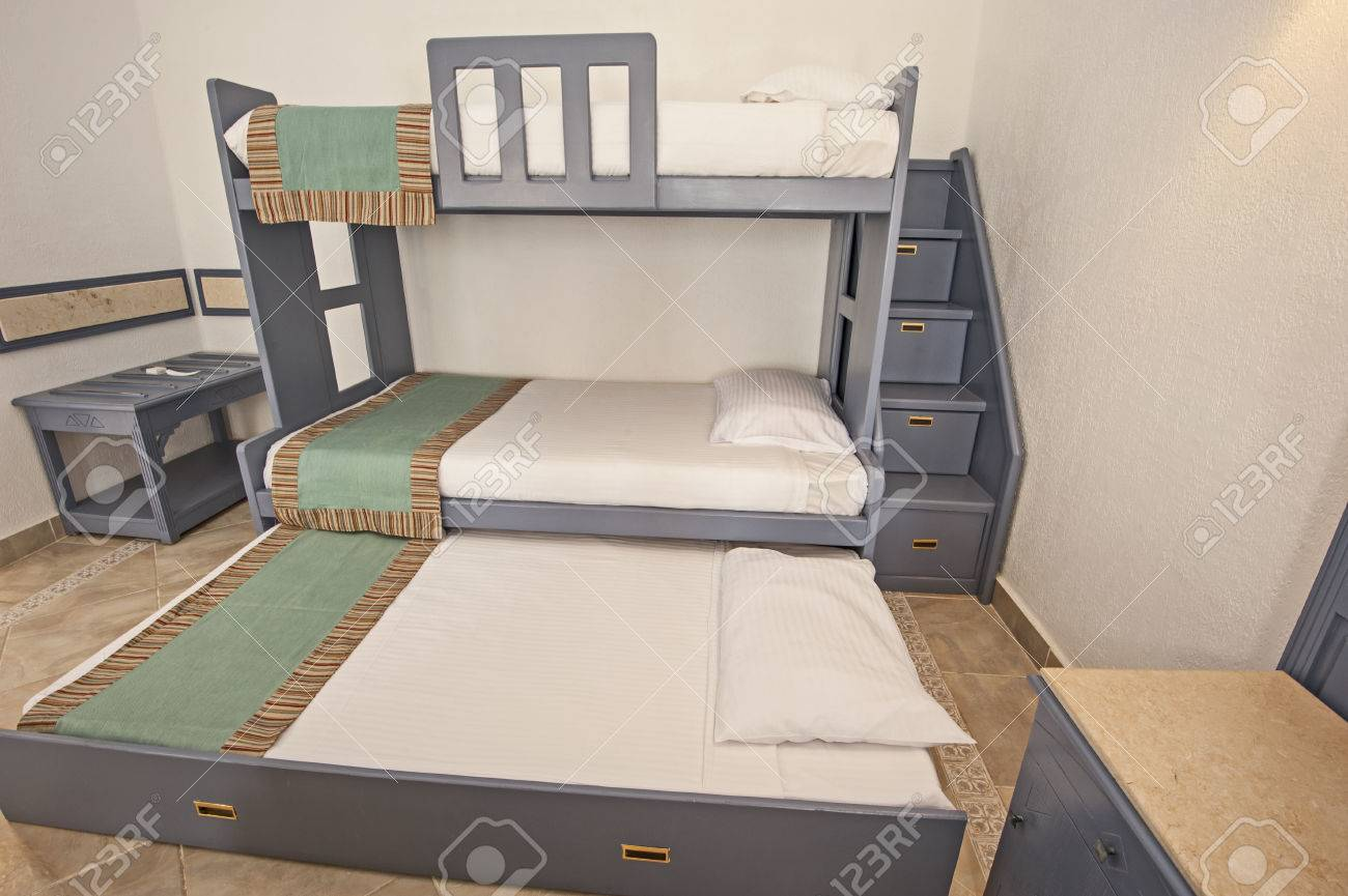 Picture of: Space Saving Bunk Beds In Family Bedroom Storage Concept Idea Stock Photo Picture And Royalty Free Image Image 53936028
