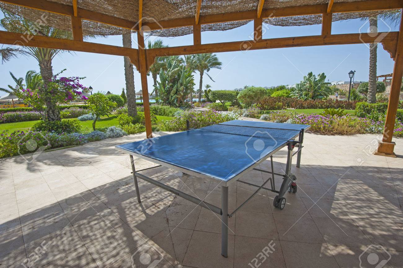 Ping Pong Table Tennis Game Under Gazebo In Tropical Gardens Of Luxury  Hotel Resort Stock Photo