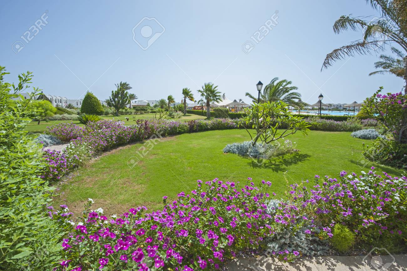 Formal Landscaped Gardens In Grounds Of A Luxury Tropical Hotel Resort  Stock Photo   60129197