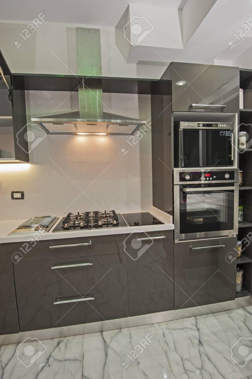 Interior Design Decor Showing Modern Kitchen And Appliances In Luxury  Apartment Showroom Stock Photo   76933615