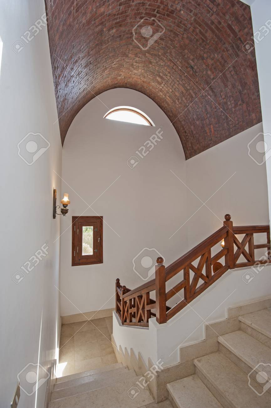 Marble Curved Staircase From Ground Floor To Upstairs In Luxury Holiday  Villa With Wooden Bannister Railing