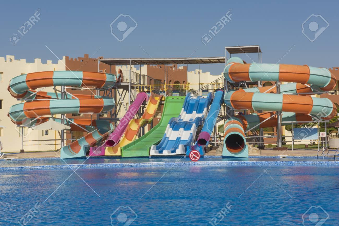 Large swimming pool with aqua park water slides at a luxury tropical..