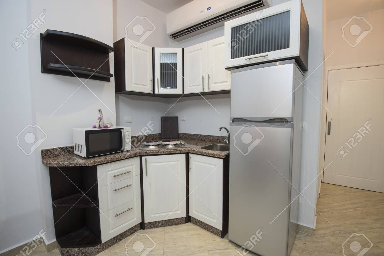 Interior decor kitchen design with appliances and furnishings..