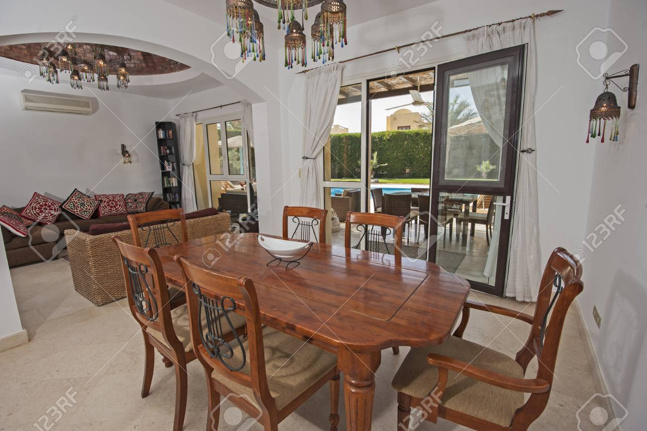 Lounge and dining area in luxury villa show home showing interior..