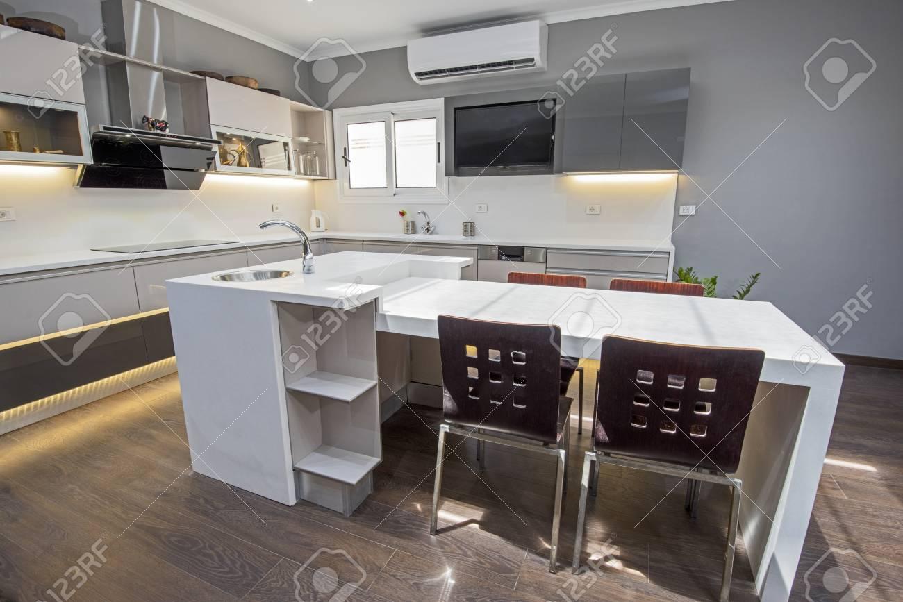 Interior design decor showing modern kitchen with cupboards in..