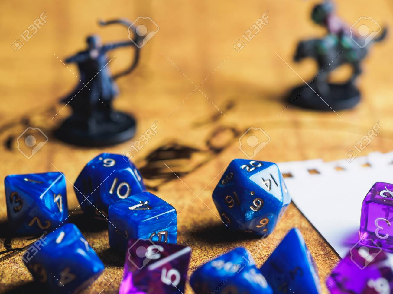 roleplay game with dragons in dungeon yellow field dice stock
