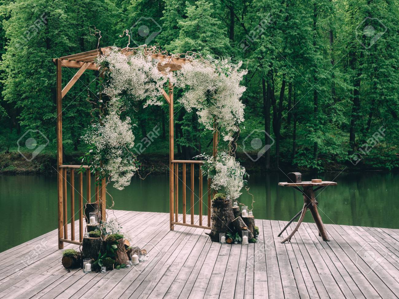 Rustic Wedding Arch.Romantic Rustic Wedding Ceremony Near River White Wooden Chairs