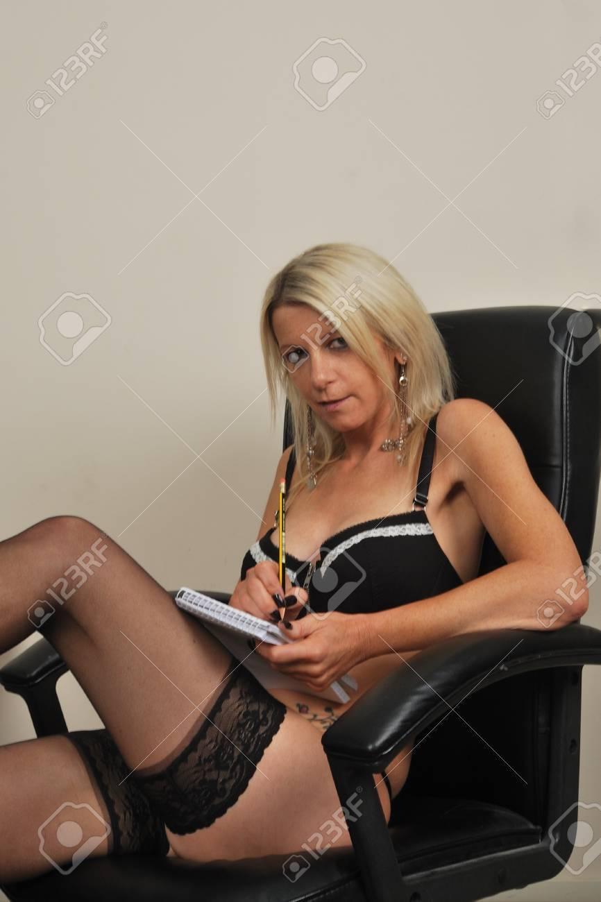 businesswoman sitting in underwear taking notes Stock Photo - 10928256