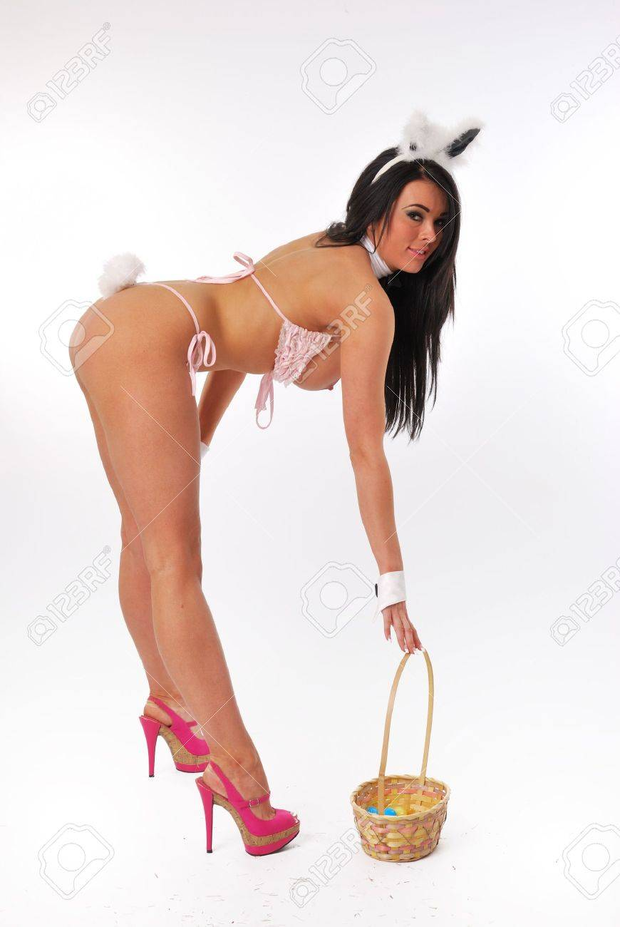 bunny girl with basket leaning forward Stock Photo - 12937530