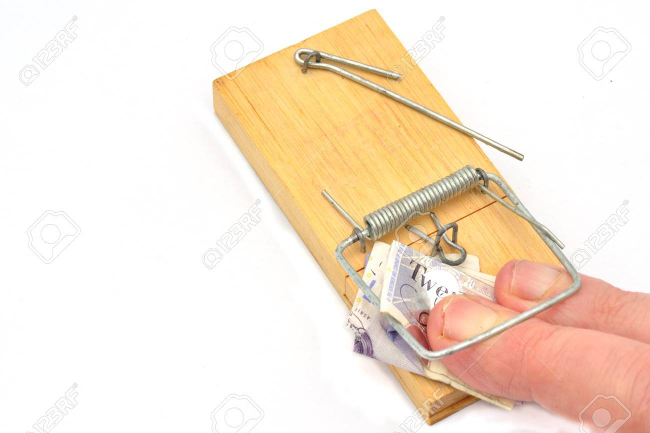 fingers trapped in mousetrap grabbing money Stock Photo - 16400846
