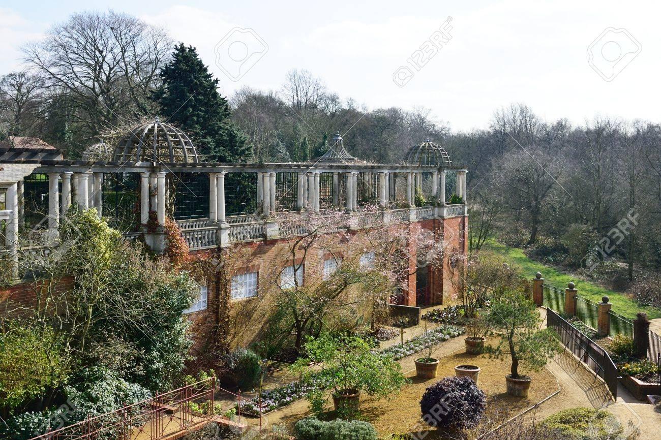 Merveilleux Pergola With Large English Garden Stock Photo   54099815