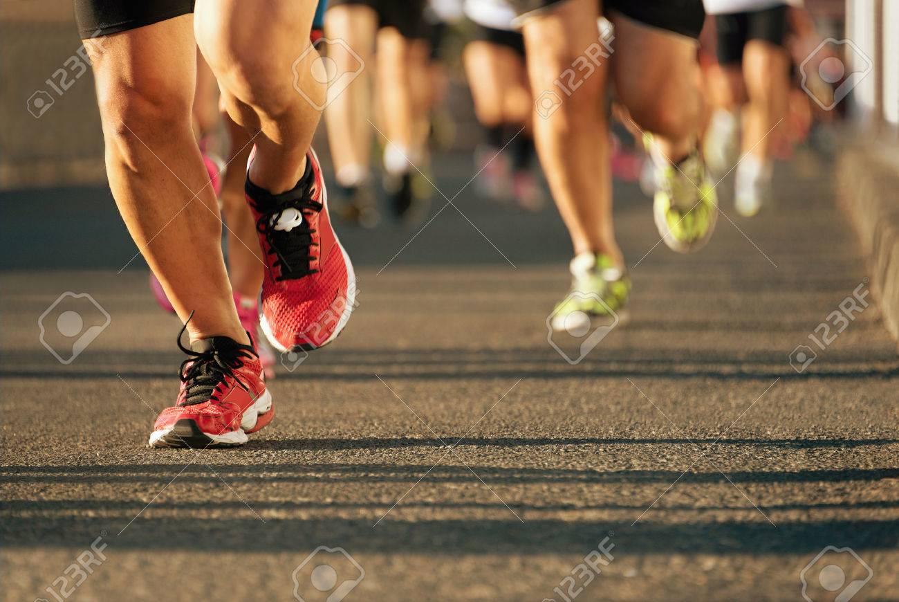Marathon running in the light of evening - 52532304