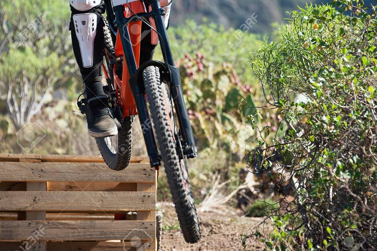 017cfe486e0 Downhill mountain bike,jump on the artificial ramp Stock Photo - 67101642